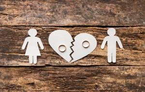 paper family near a broken heart a divorce on a wooden background