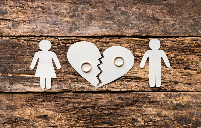 paper family near a broken heart a divorce on a wooden background